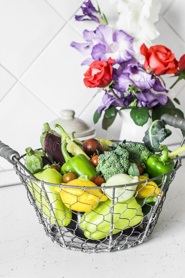 Food seasonal vegetables. Eggplant, pepper, broccoli, squash, tomatoes in a basket in the kitchen, on a light background stock photos