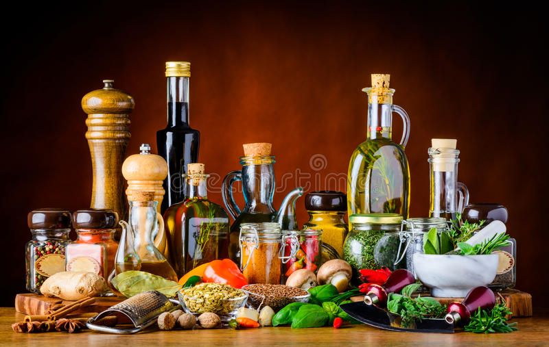 Food Seasoning Spices, herbs and Oil. Food Seasoning with different spices, herbs, vegetables, oil in still life stock photo