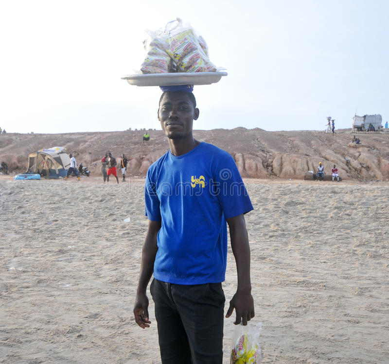 Food Seller on the Beach - Accra, Ghana. ACCRA, GHANA - MAY 1, 2012: Local Ghanaian selling peanuts on the Beach for the May 1st, Labour Day Holiday stock image