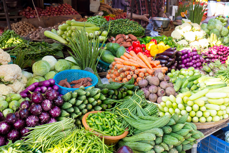 Food Seller. A Mumbai food stall with many fruits and vegetables stock images