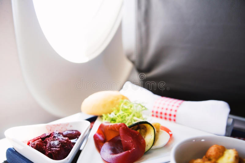 Food served on board of business class airplane on the table stock photos