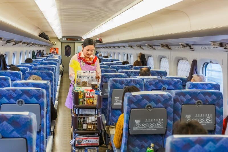 Food service in Hikari Shinkansen stock photo