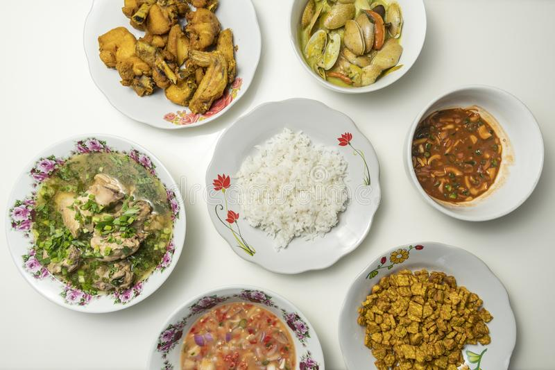 Set of asian malay food. This food set includes rice, chicken soup, tempe, air asam, budu and fried chicken api aroma asean asian background belacan berbuka bowl stock image