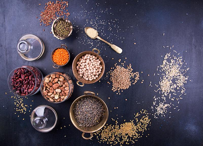 Food set of various Legumes, sereals, beans, grain and seeds. Kind of lentils, bulgur, mash, chickpeas, sunflower seeds, couscous royalty free stock images