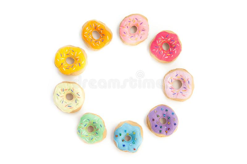 Toy food for children`s games. Hand-made donuts made of fabric,. Food is sewed from fabric for a children`s game in a shop or cafe. Donuts, hamburger, pizza stock image