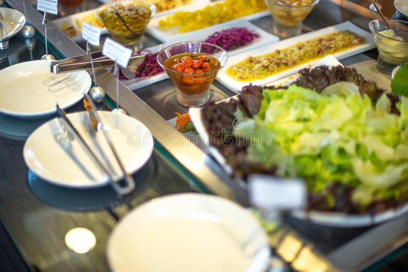 Food on the shelves in the self-service buffet. Food buffet in restaurant stock photo
