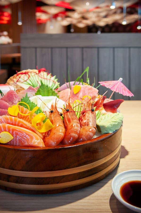 Premium Japanese seafood Sashimi, salmon, shrimp, Tuna, Otoro on. Food shot of Premium Japanese seafood Sashimi, salmon, shrimp, Tuna, Otoro on ice in bowl stock photo