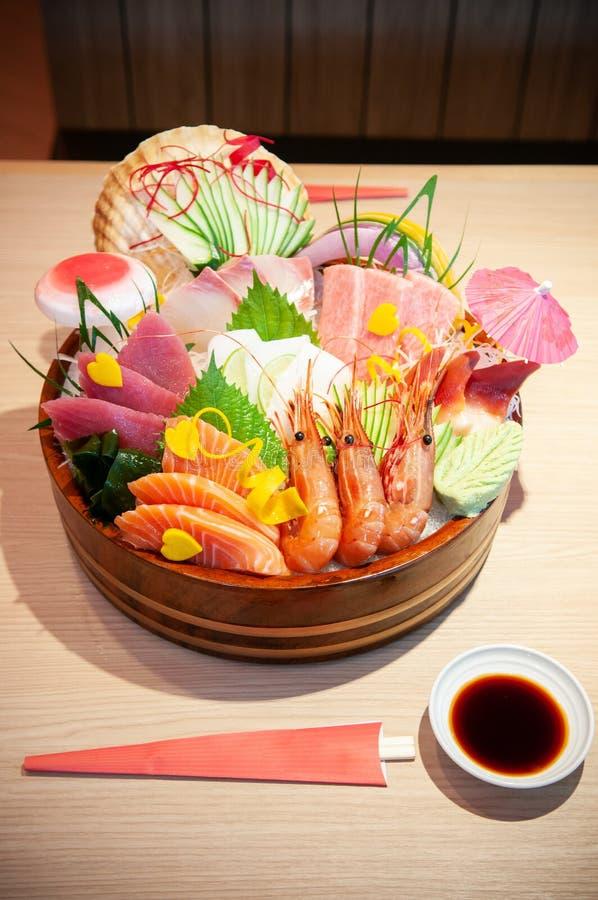 Premium Japanese seafood Sashimi, salmon, shrimp, Tuna, Otoro on. Food shot of Premium Japanese seafood Sashimi, salmon, shrimp, Tuna, Otoro on ice in bowl royalty free stock photos