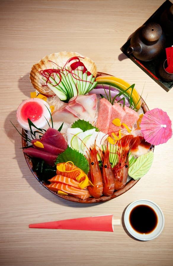 Premium Japanese seafood Sashimi, salmon, shrimp, Tuna, Otoro on. Food shot of Premium Japanese seafood Sashimi, salmon, shrimp, Tuna, Otoro on ice in bowl. Top stock photo