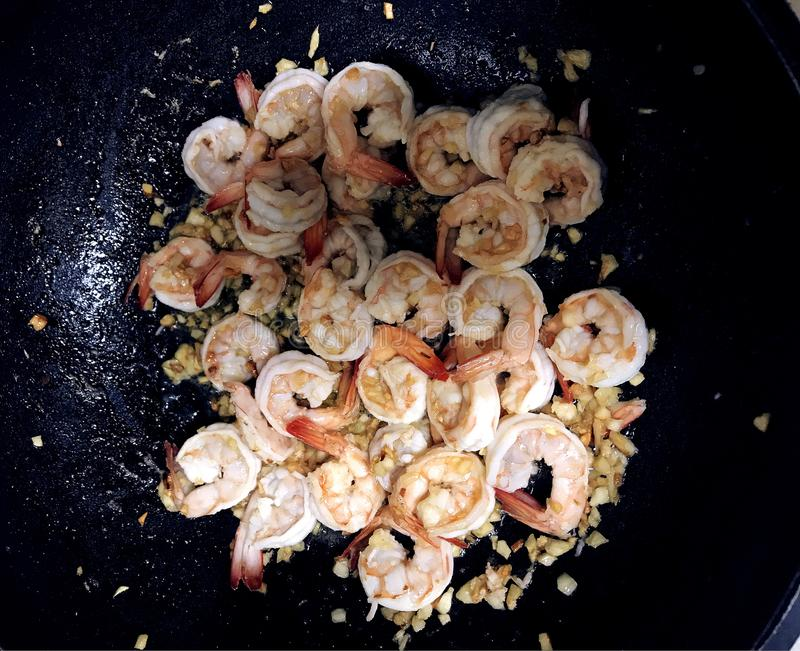 Shrimp Scampi Sauteeing in Butter and Olive Oil stock image
