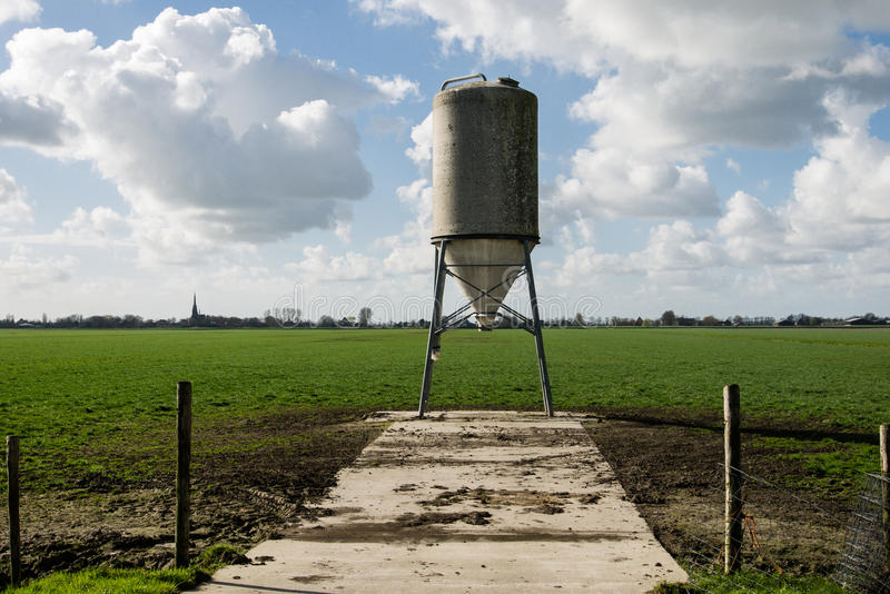 Food silo in the meadow. Food silo in the Dutch polder royalty free stock images