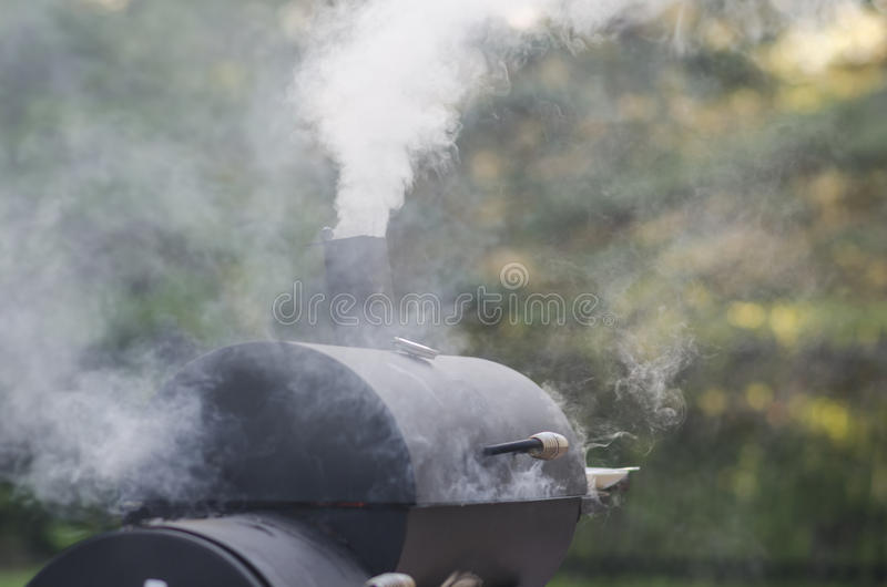 Food Smoker. BBQ and food smoker in use royalty free stock photography