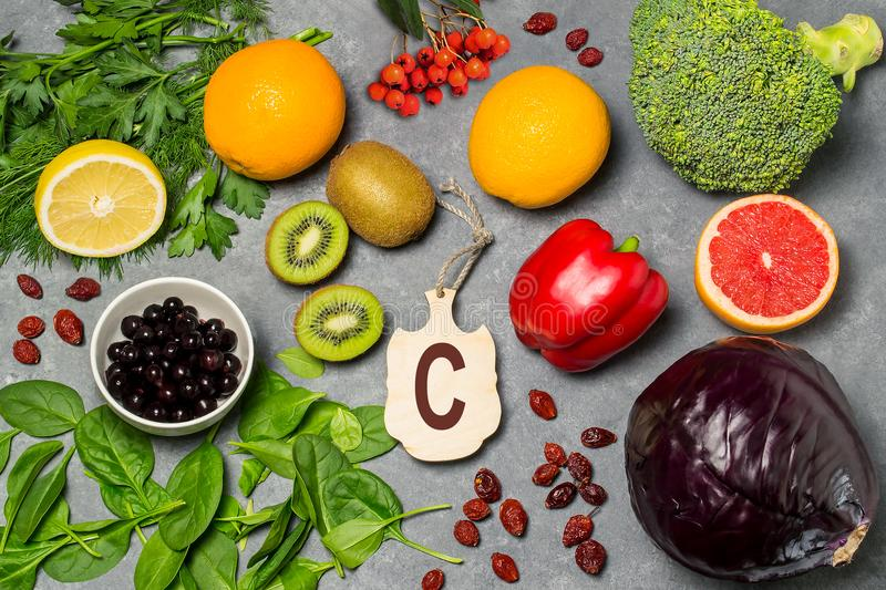 Food is source of vitamin C. Various natural food rich in vitamins. Useful food for health and balanced diet. Prevention of avitaminosis. Small cutting board royalty free stock image