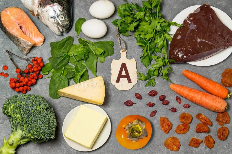 Food is source of vitamin A. Various natural food rich in vitamins. Useful food for health and balanced diet. Prevention of avitaminosis. Small cutting board royalty free stock images