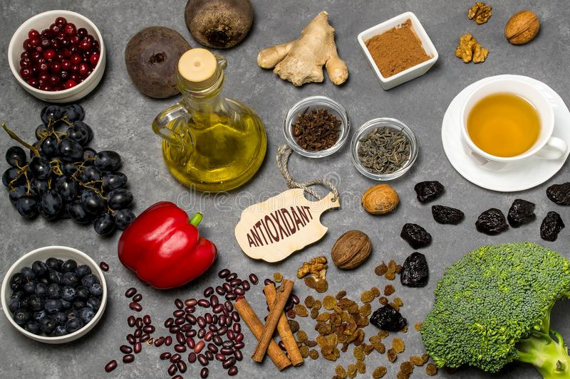 Food sources natural antioxidants. Antioxidants neutralize free radicals, have beneficial health effects. Group includes minerals, carotenoids and vitamins royalty free stock photos