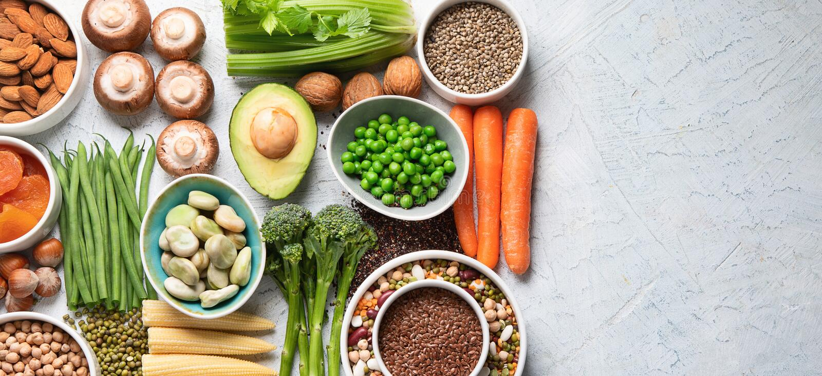 Food sources of plant based protein. Healthy diet with  legumes, dried fruit, seeds, nuts and vegetables.  Foods high in protein, antioxidants, vitamins and royalty free stock photos