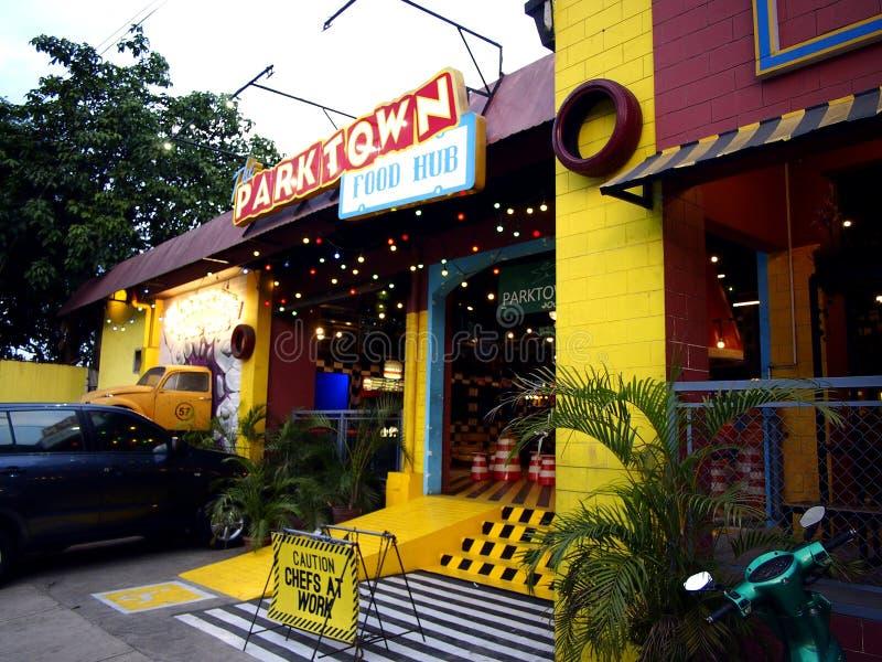 Food stalls or kiosks inside a food park in Antipolo City, Philippines. ANTIPOLO CITY, PHILIPPINES - FEBRUARY 6, 2018: Food stalls or kiosks inside a food park stock images