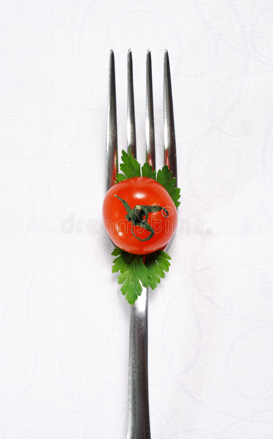 Food Still Life. With Fork and Cherry Tomato stock photos
