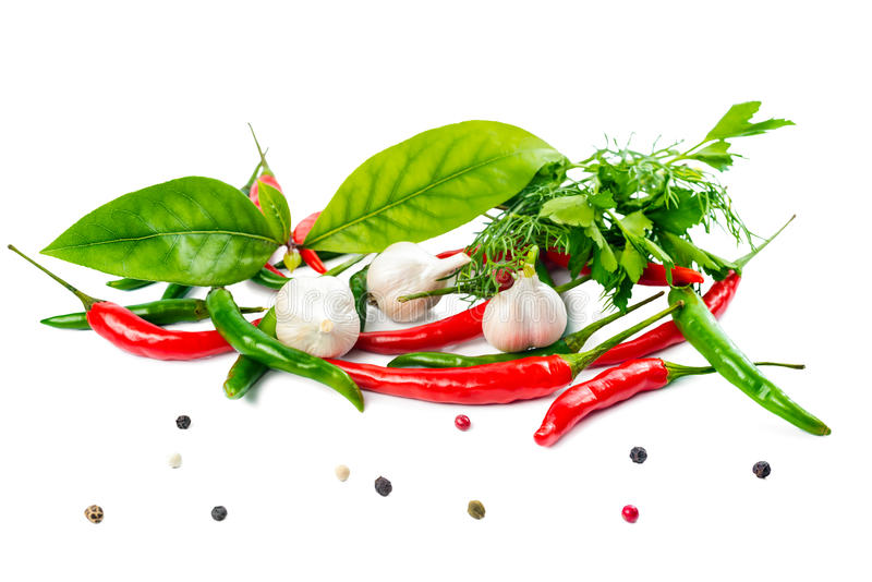 Food still life with fresh ripe red, green pepper, garlic and gr. Eens is isolated on the white background stock images