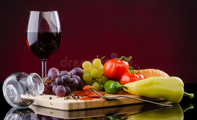 Food still life. With a glass of wine royalty free stock photos