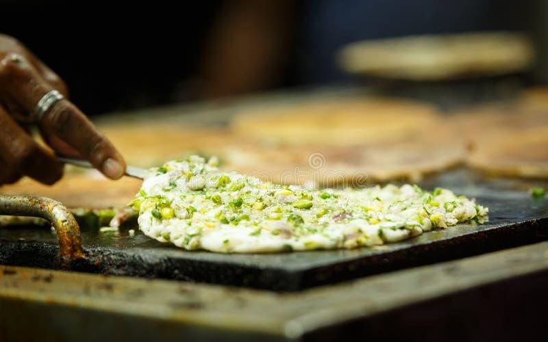 Food Street - Bangalore/Bengaluru. Preparing masala uthappam in a street shop from Bangalore food street, Bengaluru, Karnataka royalty free stock photos