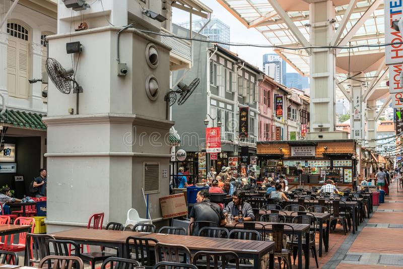 Food street in Chinatown offers seating in shade, Singapore royalty free stock images