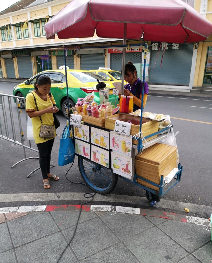 A food street seller uses an electronic tablet. On September 14, 2019 in Thai capital Bangkok stock photo