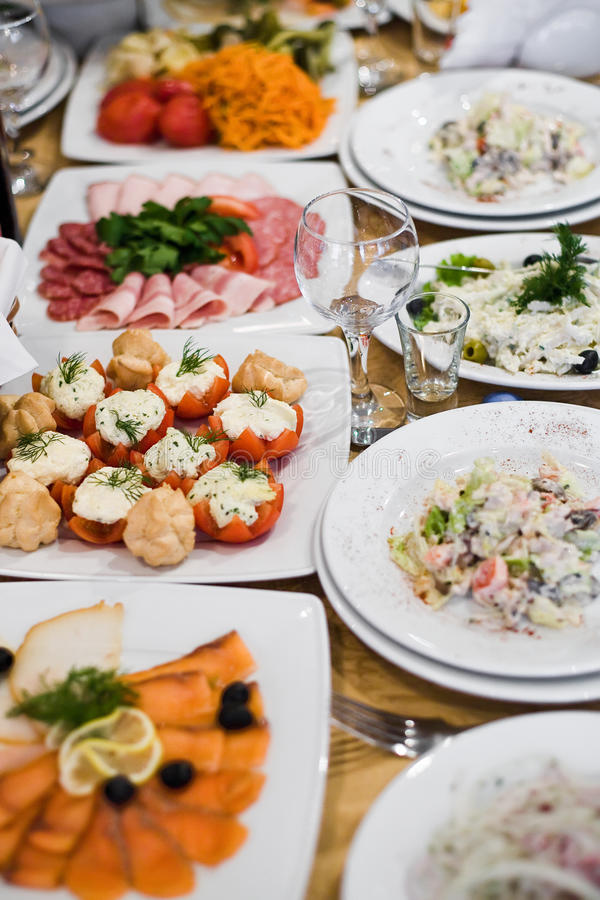 Food on the table. Salad food on the table with tomato, meat royalty free stock photography