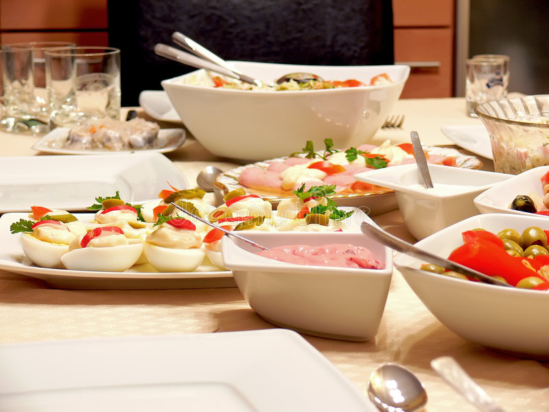 Food on a table. Close up of a variety food on a dining table royalty free stock images