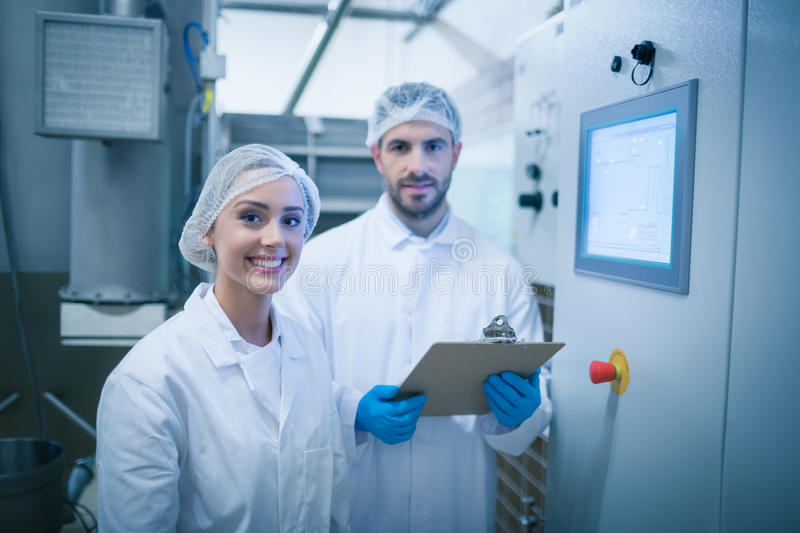 Food technicians working together stock image