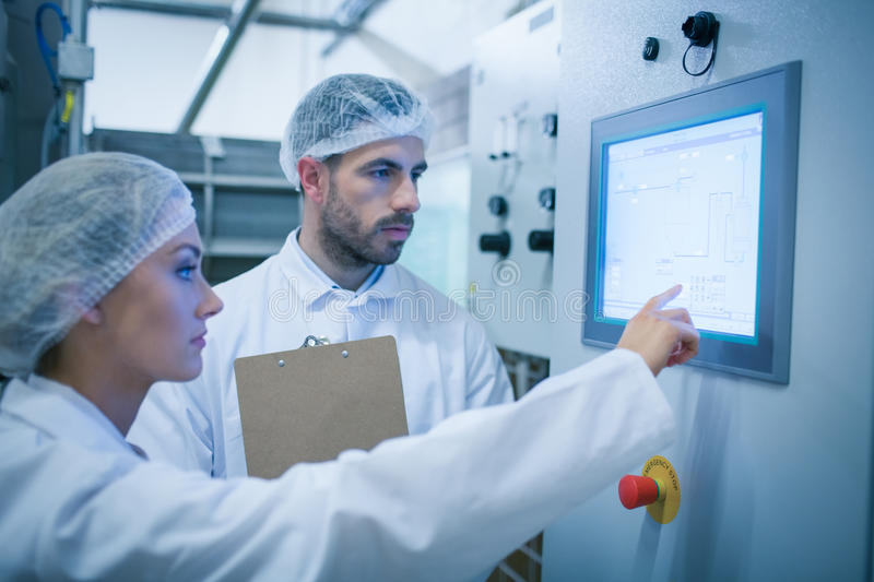 Food technicians working together royalty free stock photo