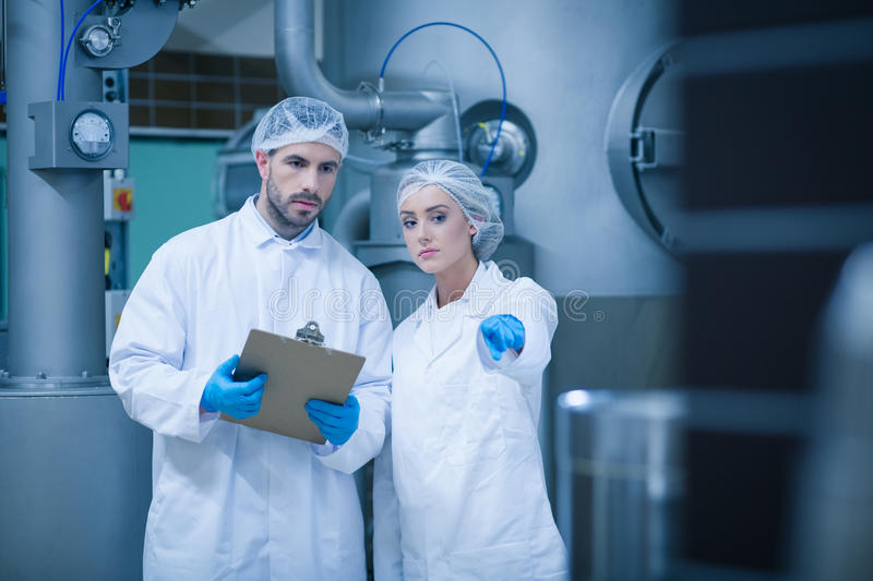 Food technicians working together stock photos