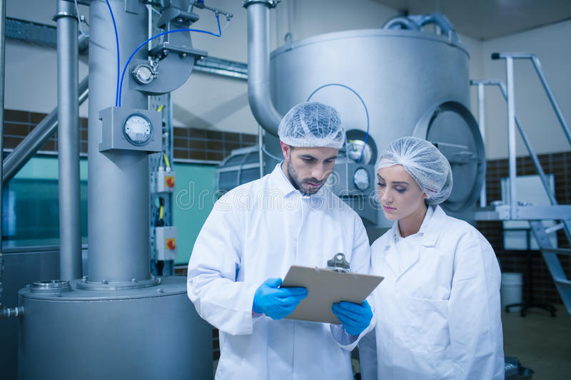 Food technicians working together. In a food processing plant royalty free stock photography