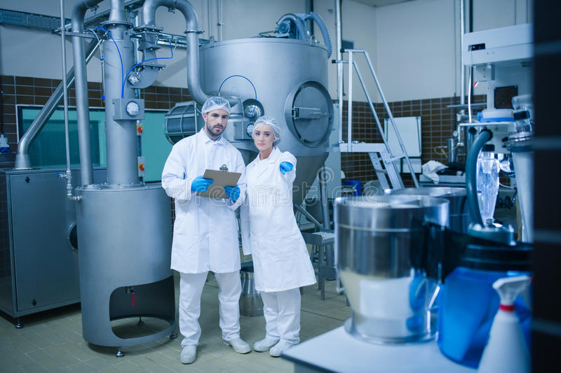 Food technicians working together royalty free stock image
