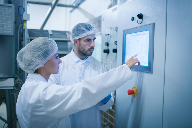 Food technicians working together. In a food processing plant stock photo