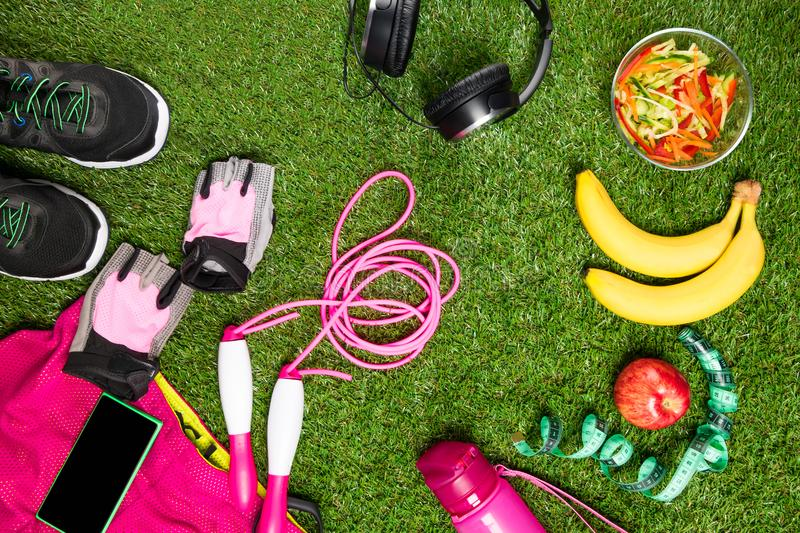 Food and things for sports, on the background of green grass. Food and things for sports, on background of green grass stock photos
