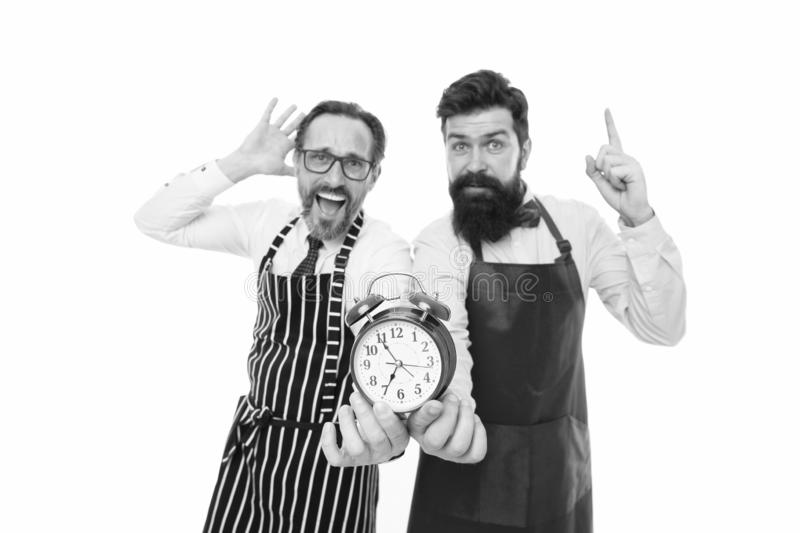 Food time. chef team in apron. Food delivery. fast food. bearded men with alarm clock. lunch time. idea. deadline. cafe. And restaurant opening. inspired men stock images
