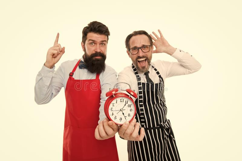 Food time. chef team in apron. Food delivery. fast food. bearded men with alarm clock. lunch time. idea. deadline. cafe. And restaurant opening. inspired men royalty free stock photo