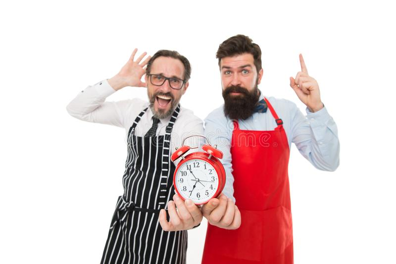 Food time. chef team in apron. Food delivery. fast food. bearded men with alarm clock. lunch time. idea. deadline. cafe. And restaurant opening. inspired men stock photos
