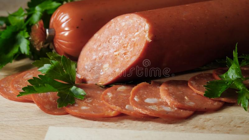 Food tray with delicious salami. Frame. Cutting sausage and cured meat on a celebratory table stock photos