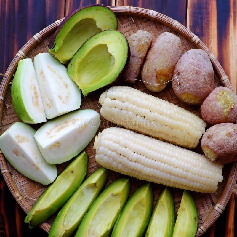 Food tray for vegetarian, sweet potato, avocado, corncob, guava royalty free stock images