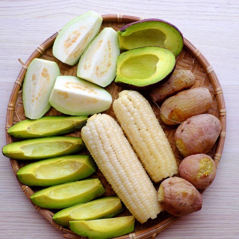Food tray for vegetarian, sweet potato, avocado, corncob, guava royalty free stock photos