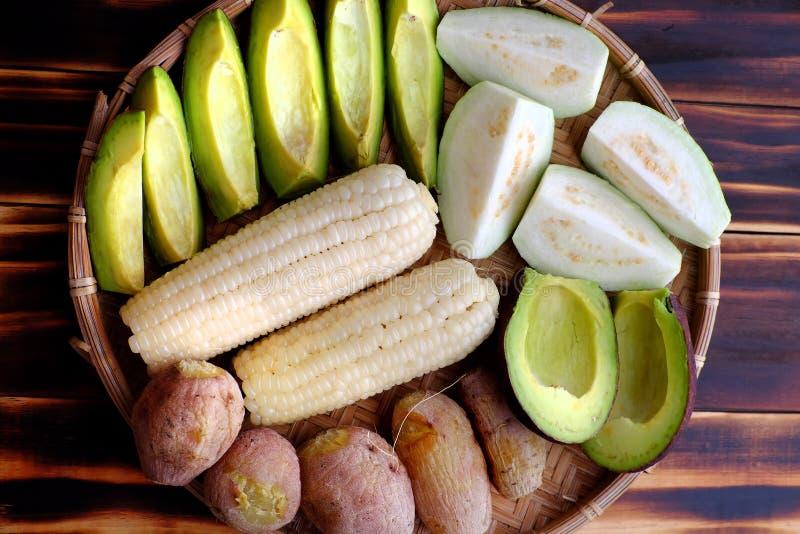 Food tray for vegetarian, sweet potato, avocado, corncob, guava stock image