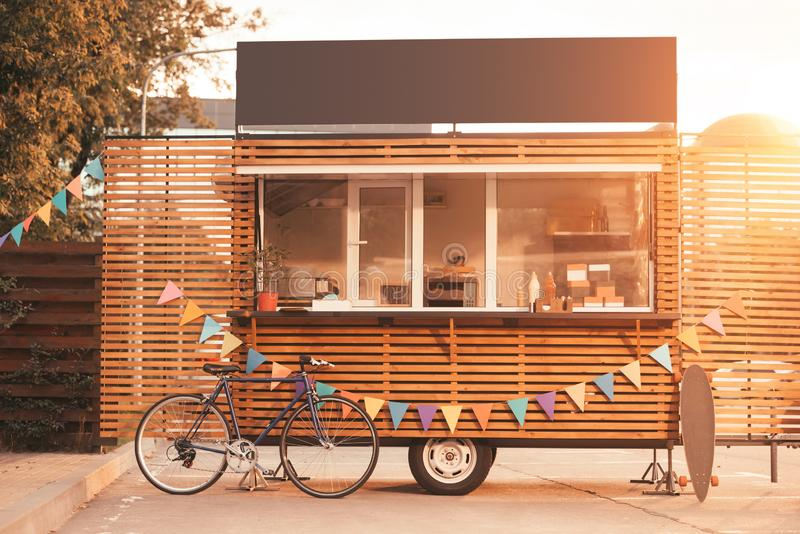 Food truck with bicycle during sunset stock images