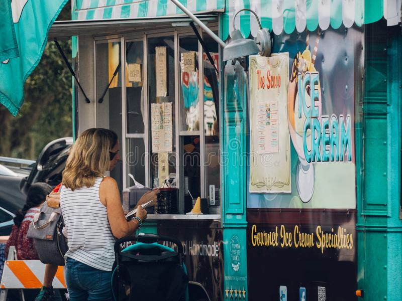 Sanford, Florida - July 20, 2019: Food Truck Customers Buying And Eating stock photography