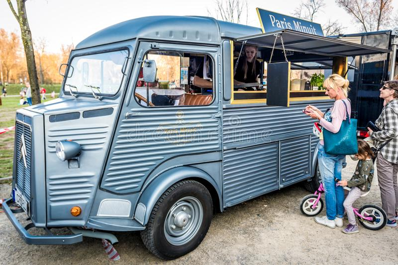 Food truck festival. Warsaw, Poland - April 1, 2017: People in front of food truck with pancakes during food festival in Warsaw royalty free stock photography