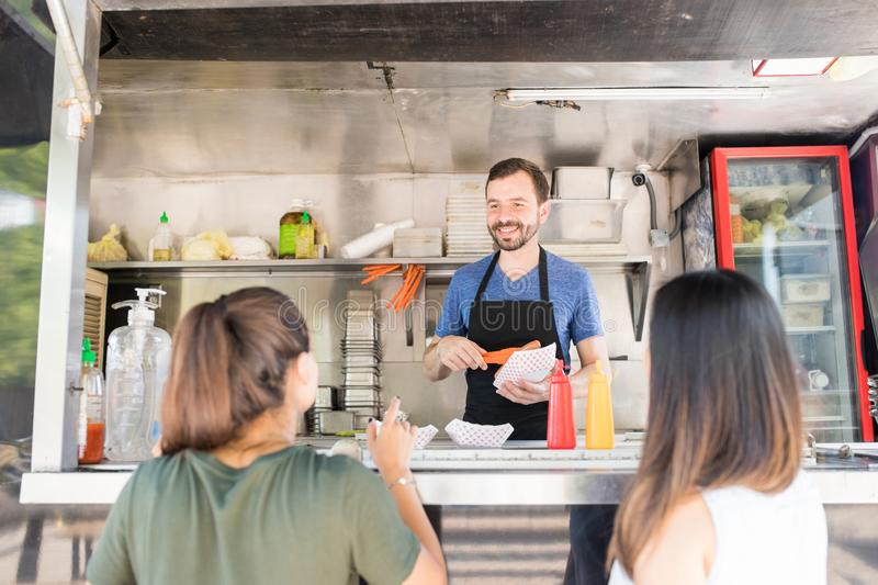 Food truck owner serving food royalty free stock photography