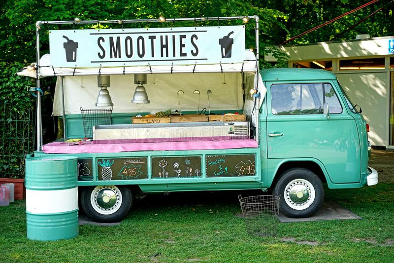 Food truck selling smoothies. Drinks, customized classic VW van stock photography