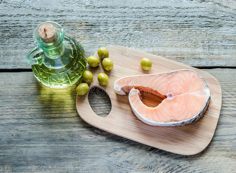 Food with unsaturated fats - salmon and olive oil. Food with healthy fats - salmon and oil stock photography