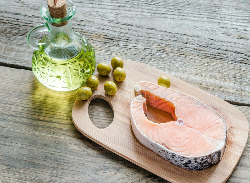 Food with unsaturated fats - salmon and olive oil. Food with healthy fats - salmon and oil royalty free stock photo